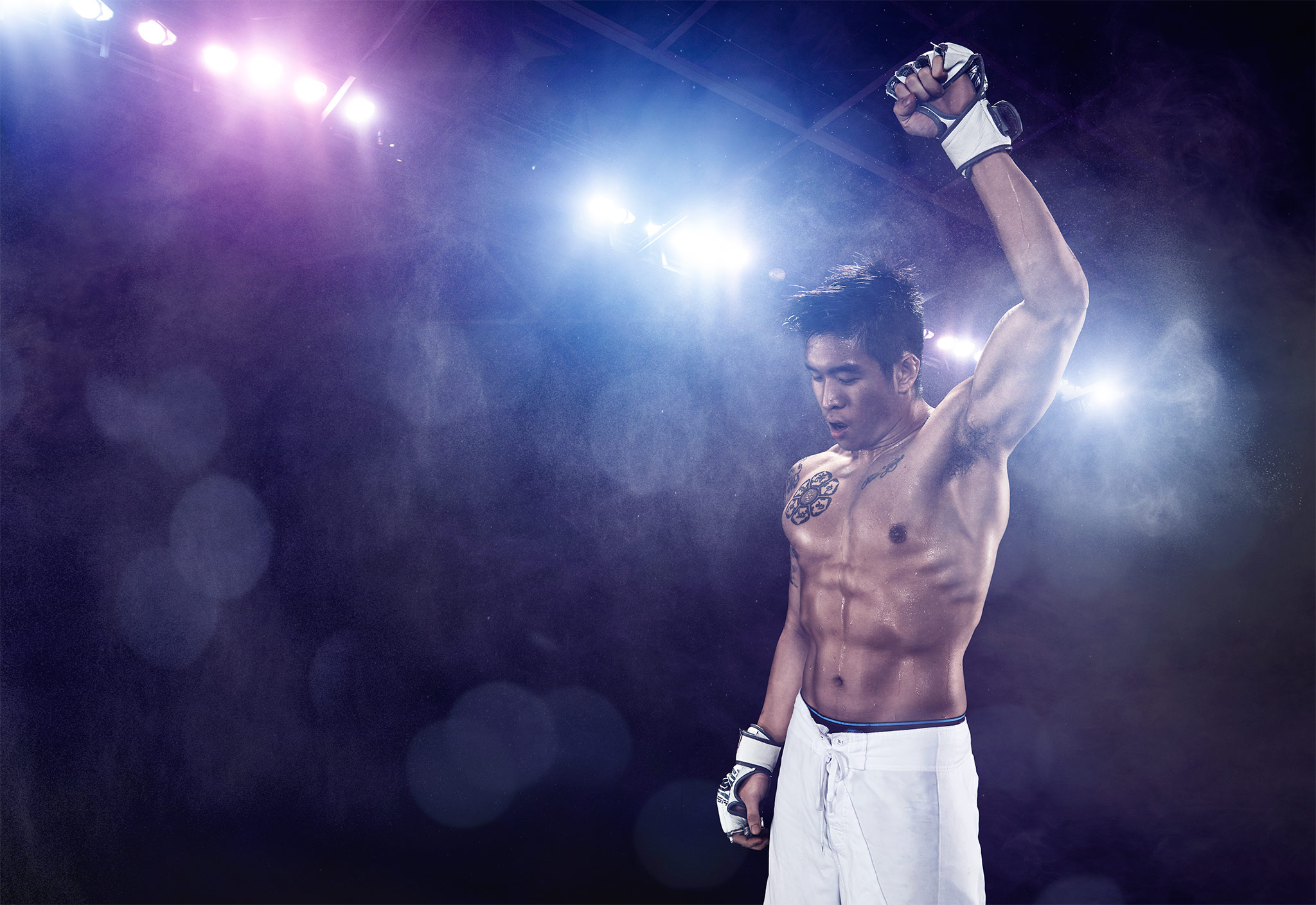 MMA Athlete Raises Hand in Victory | Zach Ancell Photography