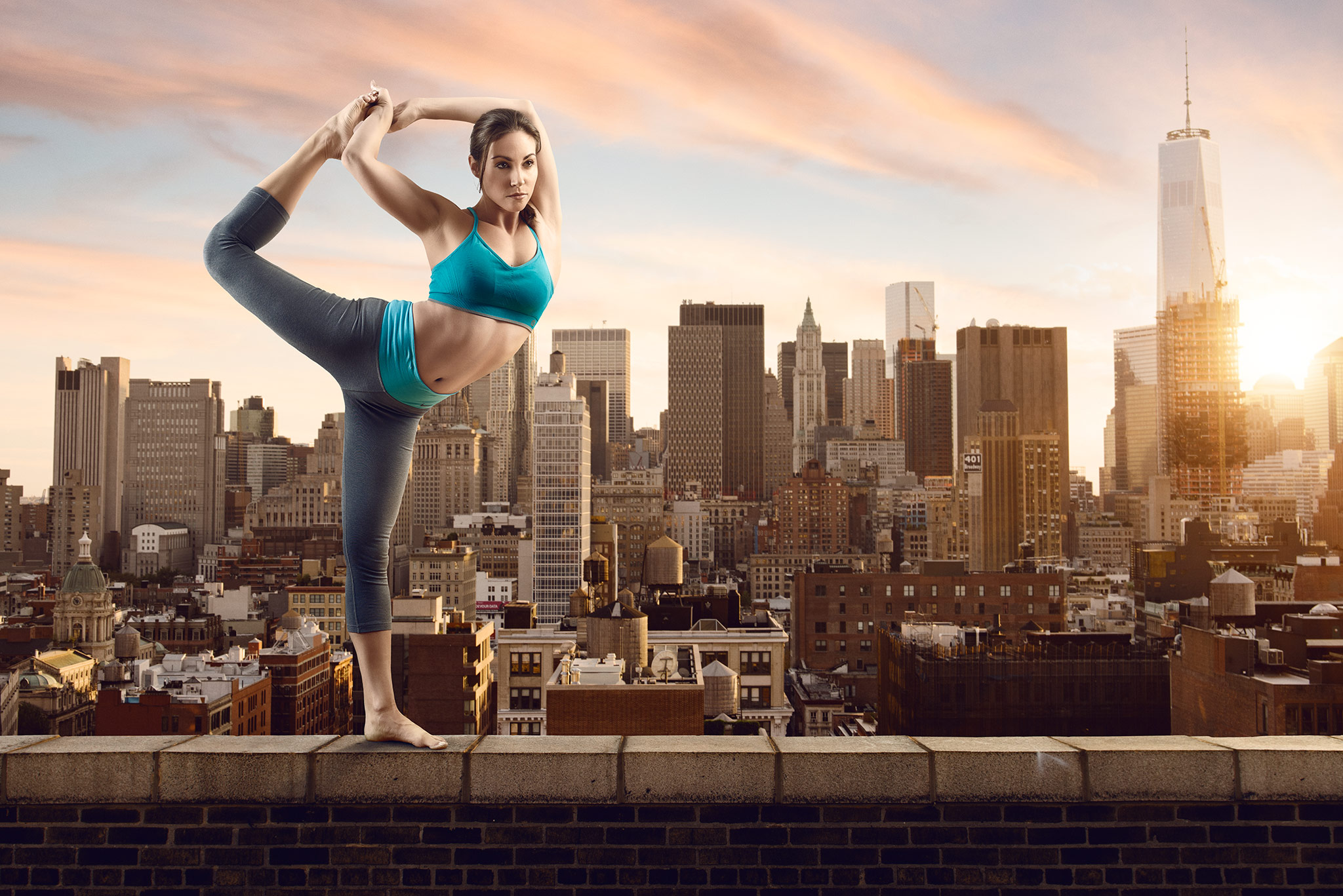 Woman Stretching On Ledge In City