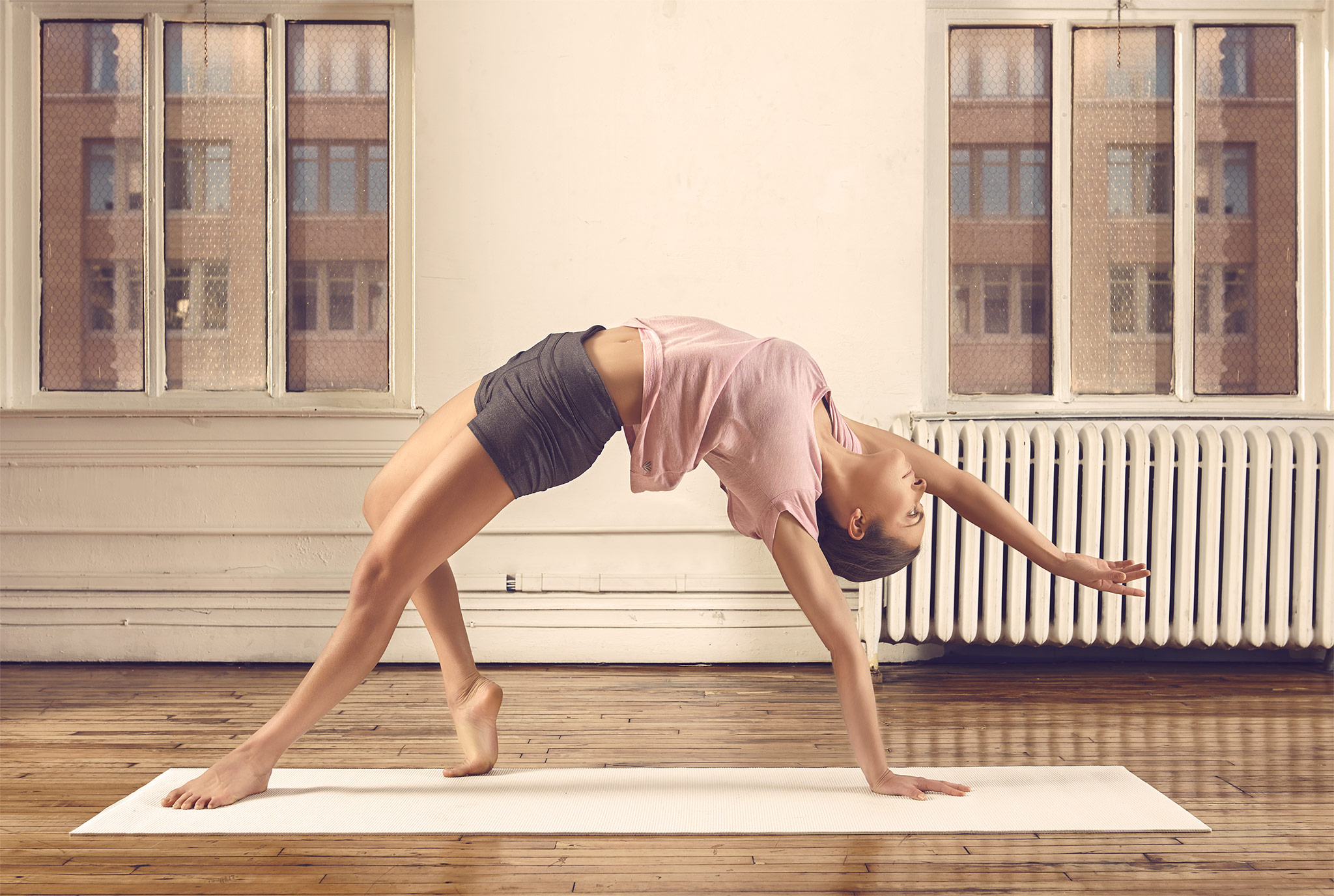 Model Bridge Stretch in Yoga Loft | Zach Ancell Photography
