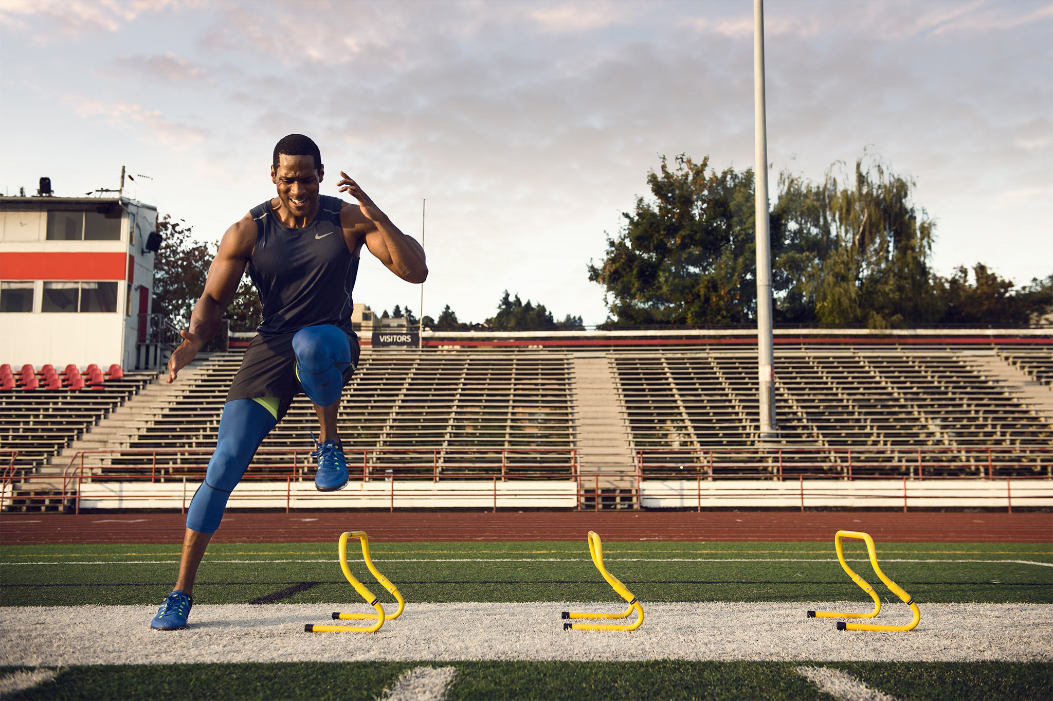 Male Trainer Demonstrates Speed Hurdles | Zach Ancell Photography