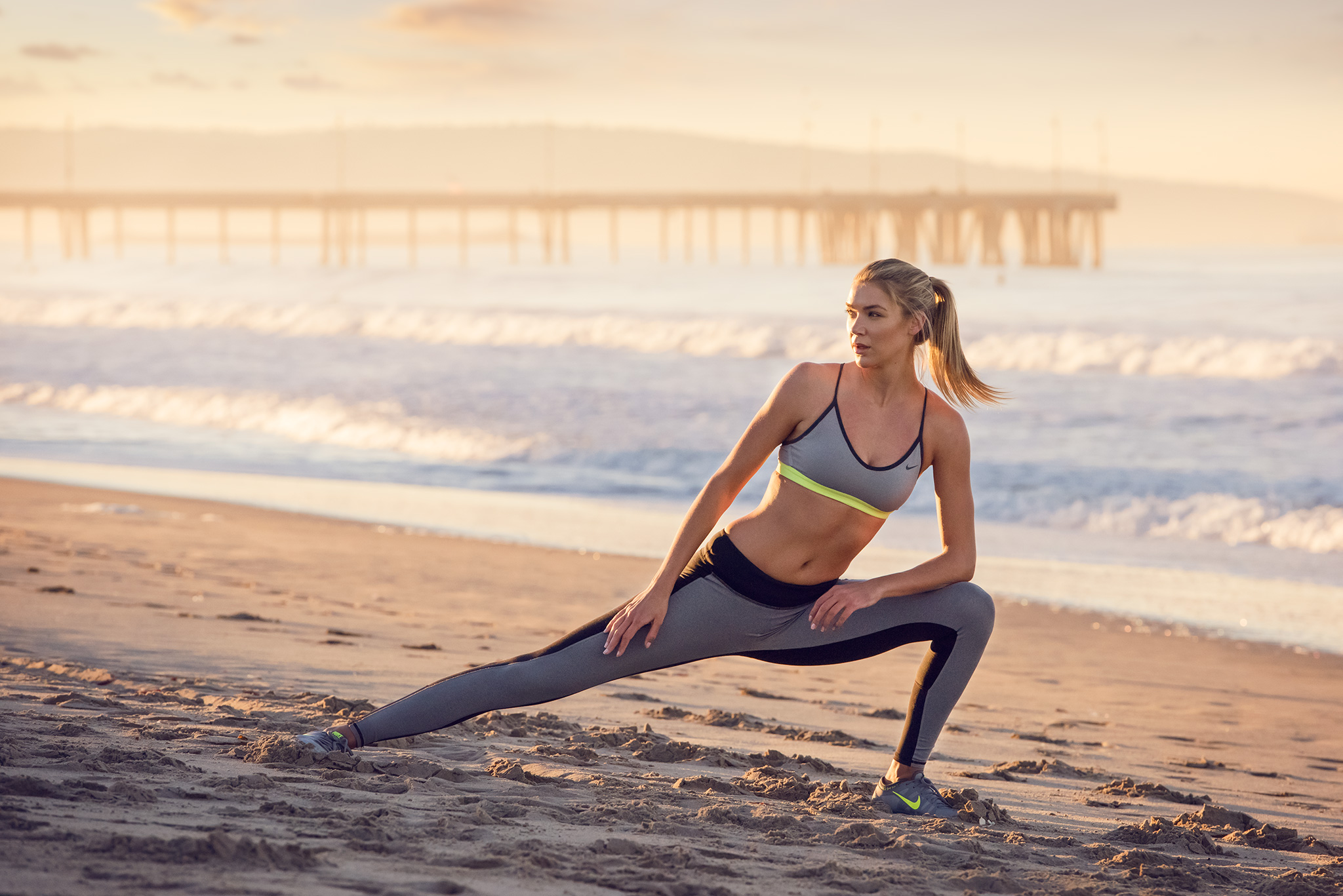 Fit Model Stretches on the Beach | Zach Ancell Photography