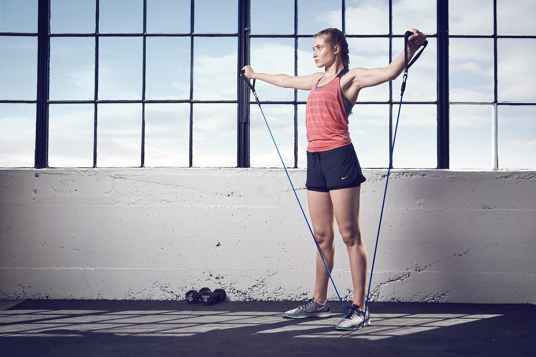 Girl Exercises with Resistance Bands | Zach Ancell Photography
