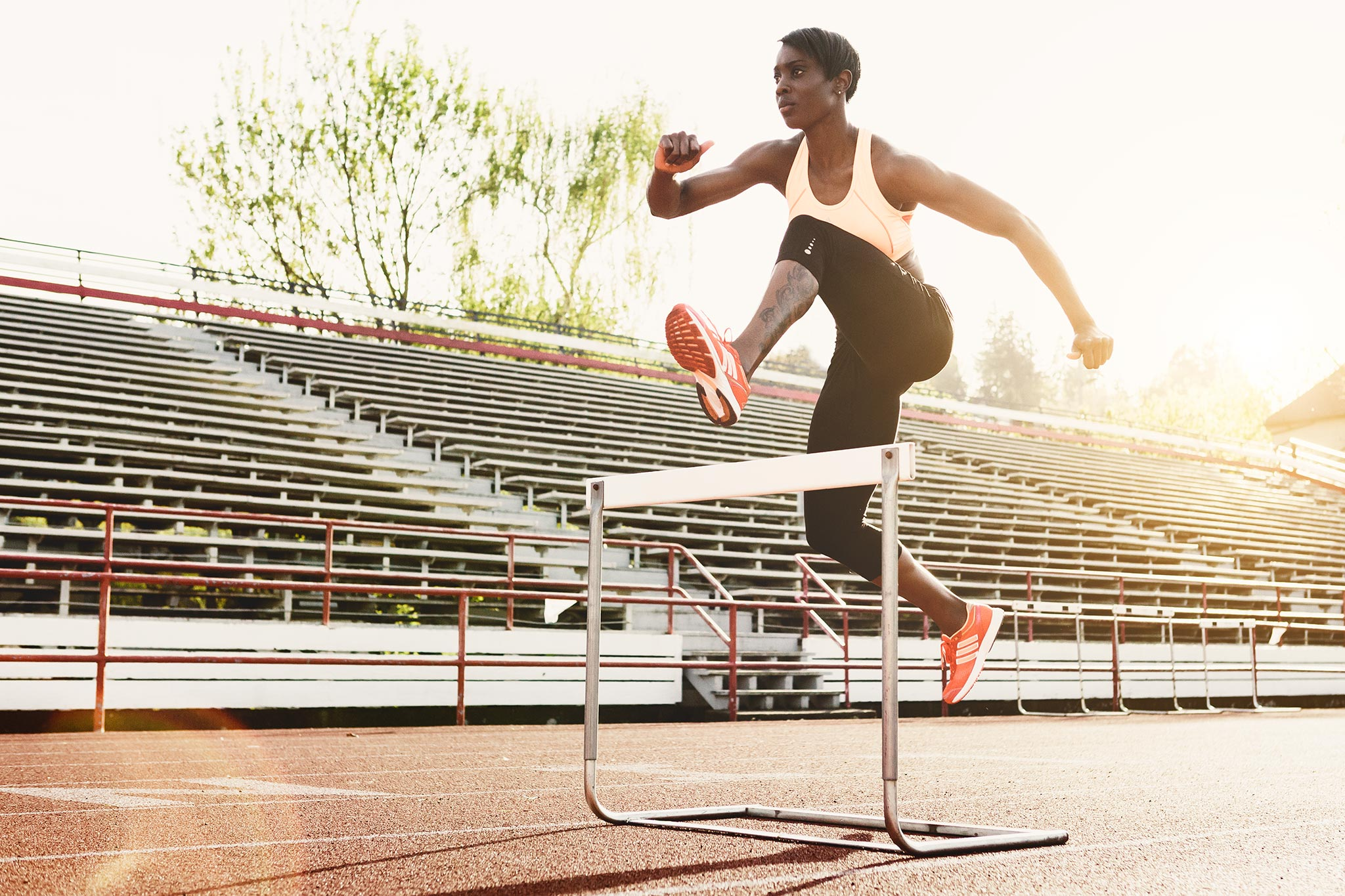 Woman Track Runner Jumps Hurdles | Zach Ancell Photography