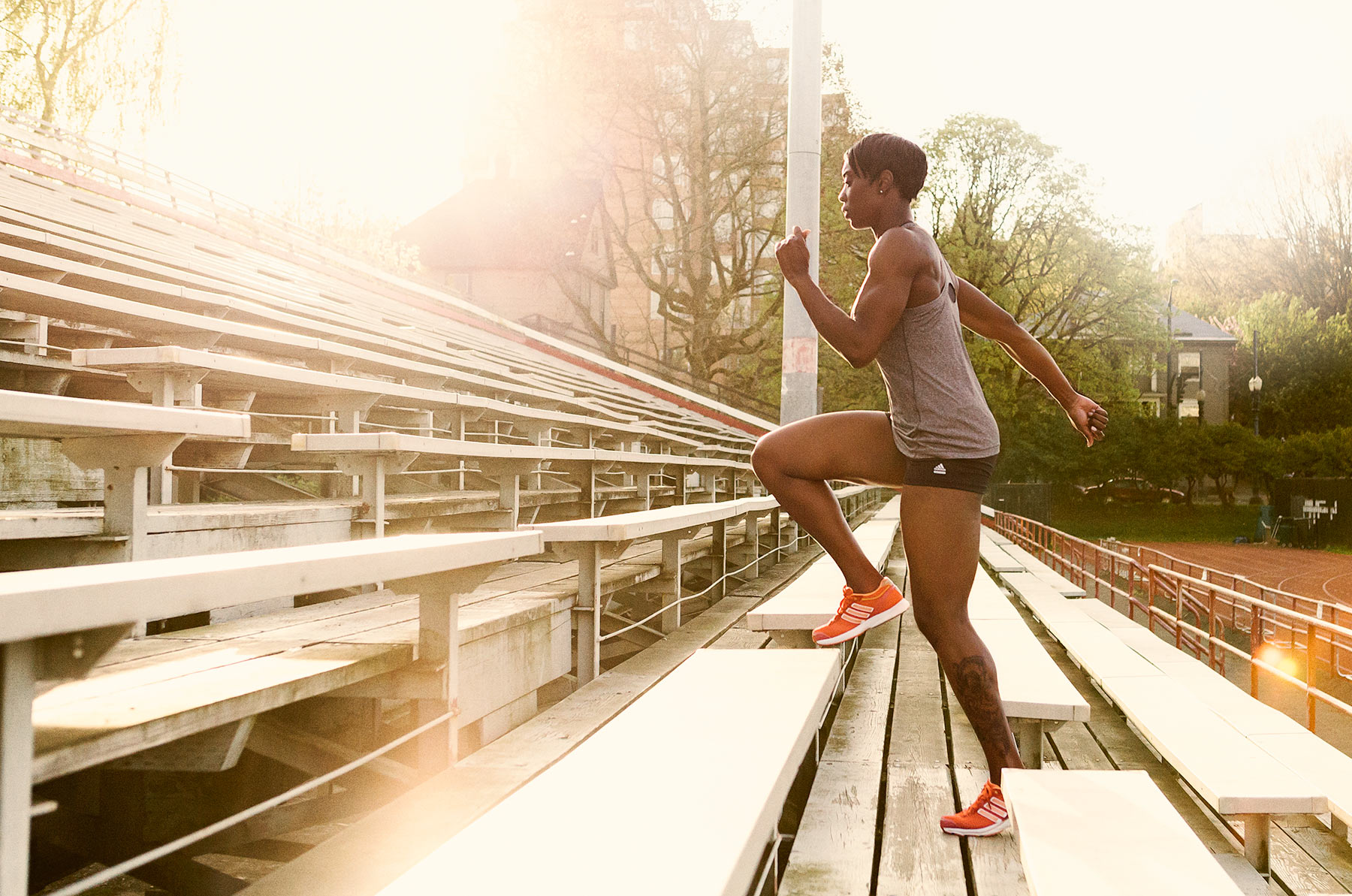 Female Athlete Running Bleachers | Zach Ancell Photography