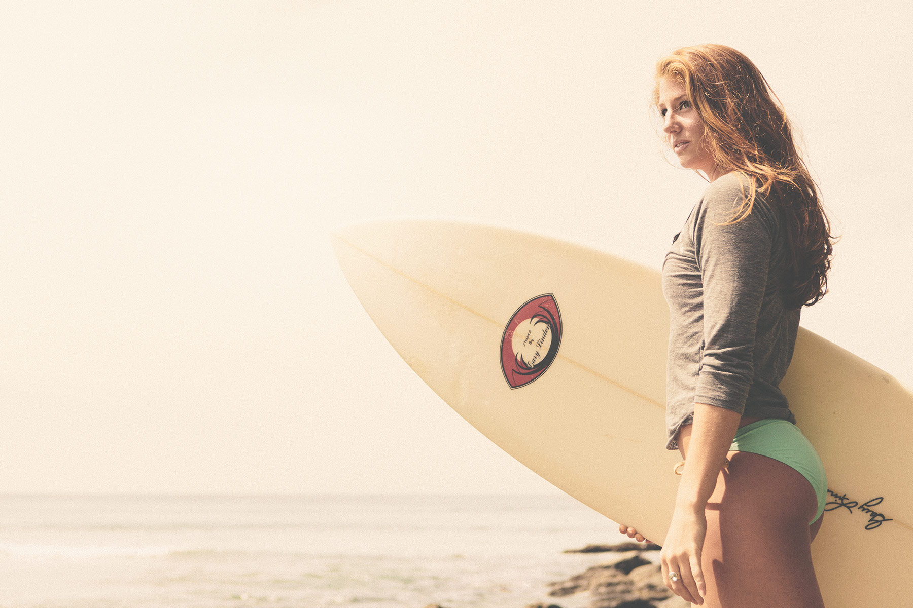 Surfer Girl Stands with Her Board | Zach Ancell Photography